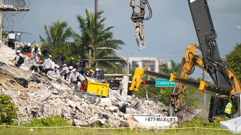 Rescue workers search in the rubble at the Champlain Towers South condominium. Pic: AP