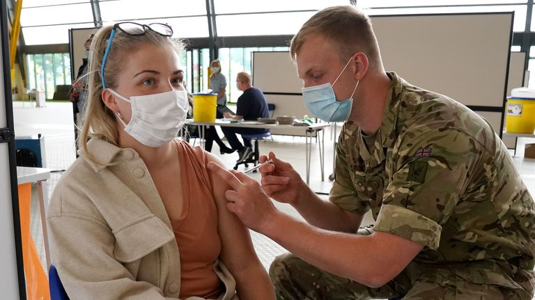 A member of the Armed Forces administers a vaccination to Mika Callaghan from Glasgow at the vaccination centre at Ravenscraig Regional Sports Facility in Motherwell, Scotland. Picture date: Friday June 11, 2021.