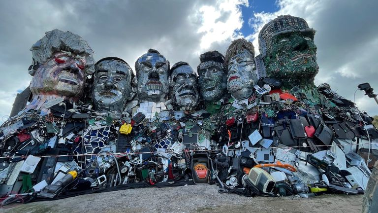 Mount Recyclemore: The E7, which has been created out of e-waste, in the likeness of the G7 leaders and in the style of Mount Rushmore by British artist Joe Rush
