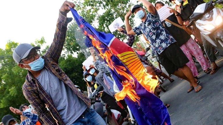 Protestors against Myanmar's junta burn the Association of Southeast Asian Nations (ASEAN) flag