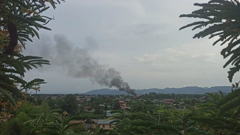 Smoke rises as security forces fight with rebels opposing the ruling junta in Mobye, Myanmar