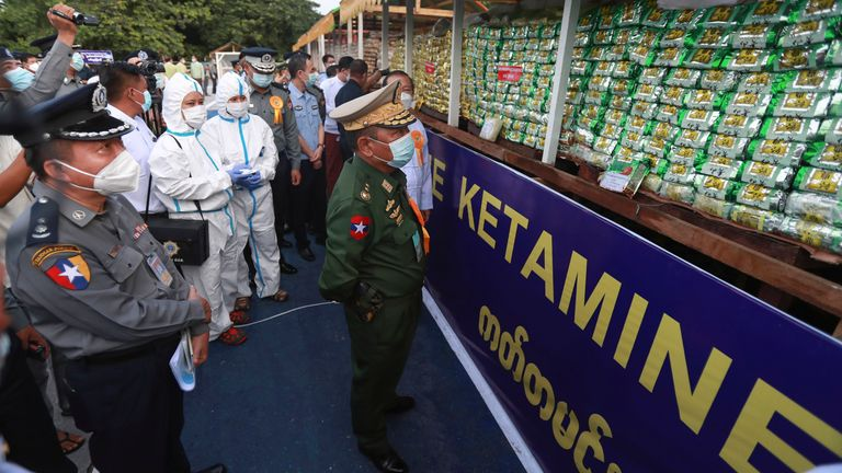 Home Affair Minister, Lieutenant General Soe Htut, center, inspects seized illegal drugs before being burnt during a destruction ceremony on the outskirts of Yangon, Myanmar, Saturday, June 26, 2021. Myanmar burned over US$ 680 million worth of assorted drugs seized around the country on Saturday to commemorate the International Day against Drug Abuse and Illicit Trafficking. (AP Photo/Thein Zaw)