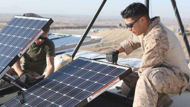A US Marine installs a solar panel