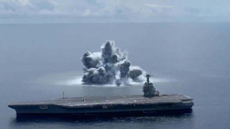 Live explosives are detonated near the USS Gerald Ford to simulate aspects of actual combat conditions.