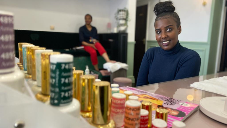 Nejat Salih a refugee from Eritrea, received help to set up her beauty business