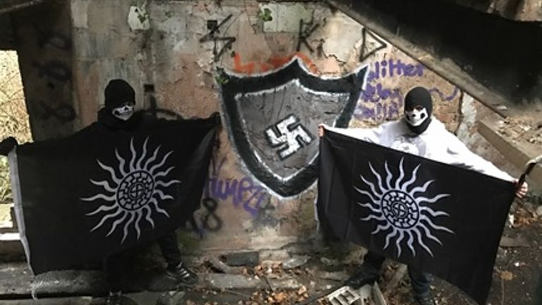 Andrew Dymock claimed he had not noticed the swastika behind him while he was being photographed Pic: Gardham/NWCTU