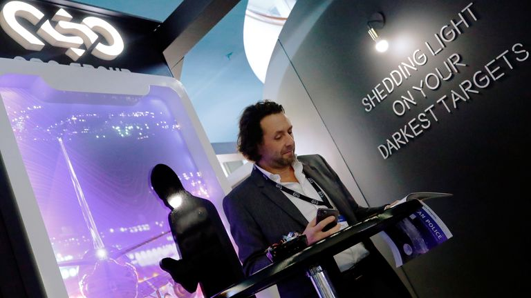 A man reads at a stand of the NSO Group Technologies, an Israeli technology firm known for its Pegasus spyware enabling the remote surveillance of smartphones, at the annual European Police Congress in Berlin, Germany, February 4, 2020