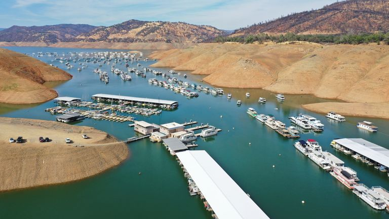 An aerial view shows houseboats anchored in low water levels at Lake Oroville, which is the second largest reservoir in California