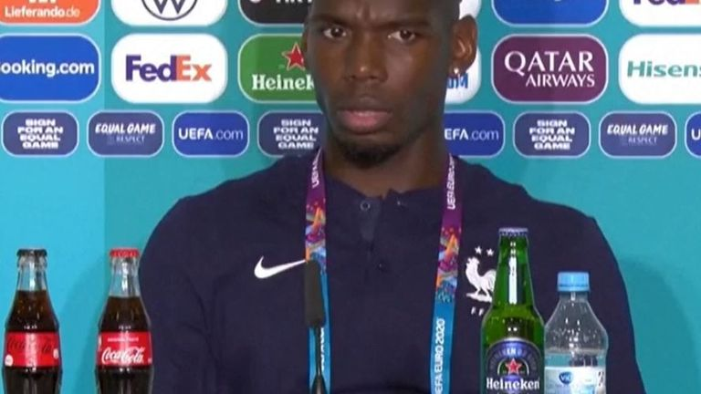 Paul Pogba stares at beer bottle before removing it
