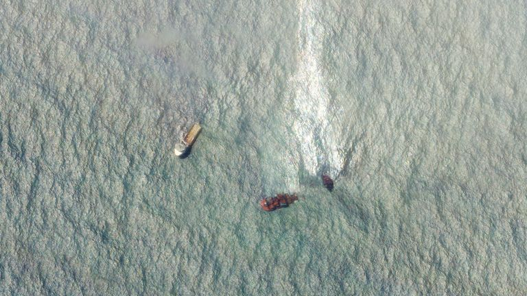 Satellite images show a huge oil slick flowing from part of the damaged ship. Pic: Planet Labs
