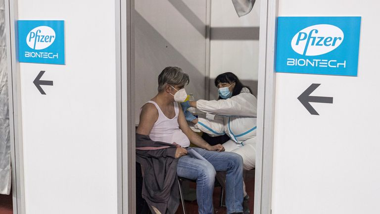 FILE PHOTO: A man receives a second dose of the Pfizer-BioNTech vaccine against the coronavirus disease (COVID-19) at the hall three of the Belgrade Fair, in Belgrade, Serbia, April 13, 2021. REUTERS/Marko Djurica/File Photo