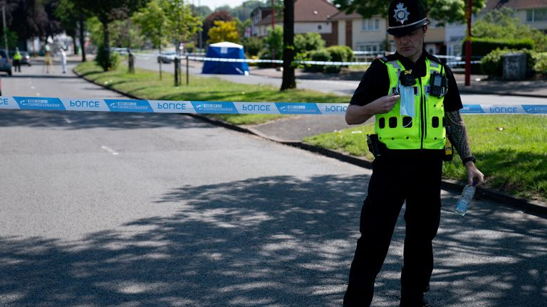 A police cordon is in place as officers hunt up to seven attackers