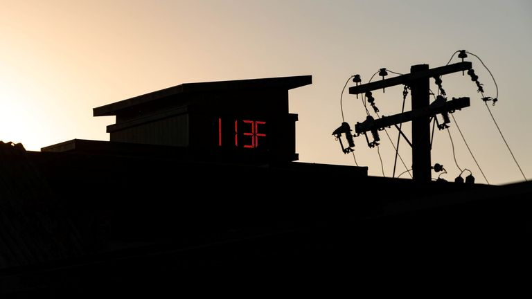 A thermometer reads 113F in Portland, Oregon