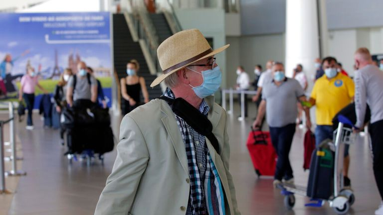 A British passenger is pictured at Faro airport