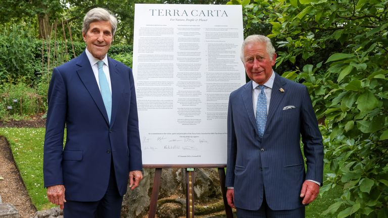 America's special envoy for climate, John Kerry, poses with Prince Charles at St James Palace