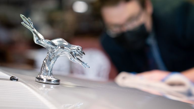 The replica silver frog on the car's bonnet
