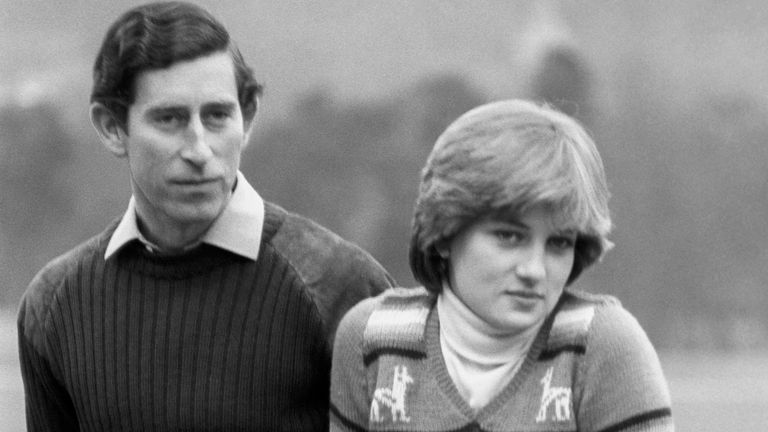 Prince of Wales and his fiance Lady Diana Spencer, relaxing on a fence at Balmoral in 1981
