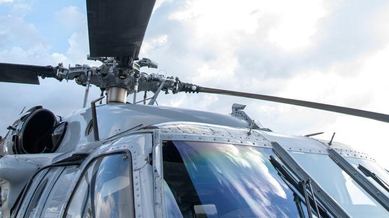 The mark of a projectile impact is seen on the propeller of a helicopter where Colombian President Ivan Duque was travelling in