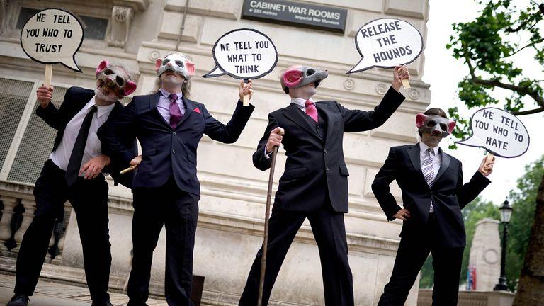 Extinction Rebellion demonstrators wear rat masks in Whitehall, London