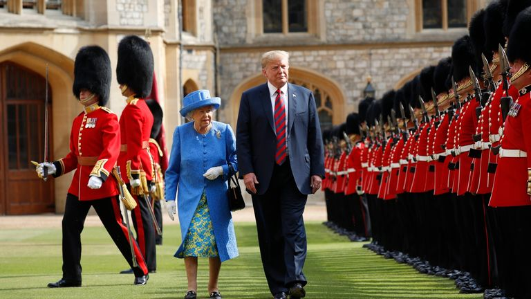 FILE - In this Friday, July 13, 2018 file photo, U.S. President Donald Trump and Britain's Queen Elizabeth inspects the Guard of Honour at Windsor Castle in Windsor, England. U.S. President Donald Trump will pay a state visit to Britain in June as a guest of Queen Elizabeth II, Buckingham Palace said Tuesday, April 23, 2019. The palace said Trump and his wife, Melania, had accepted an invitation from the queen for a visit that will take place June 3-5. (AP Photo/Pablo Martinez Monsivais, file)