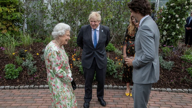 Britain's Queen Elizabeth, Canada's Prime Minister Justin Trudeau and Britain's Prime Minister Boris Johnson attend a drinks reception on the sidelines of the G7 summit, at the Eden Project in Cornwall, Britain June 11, 2021. Jack Hill/Pool via REUTERS