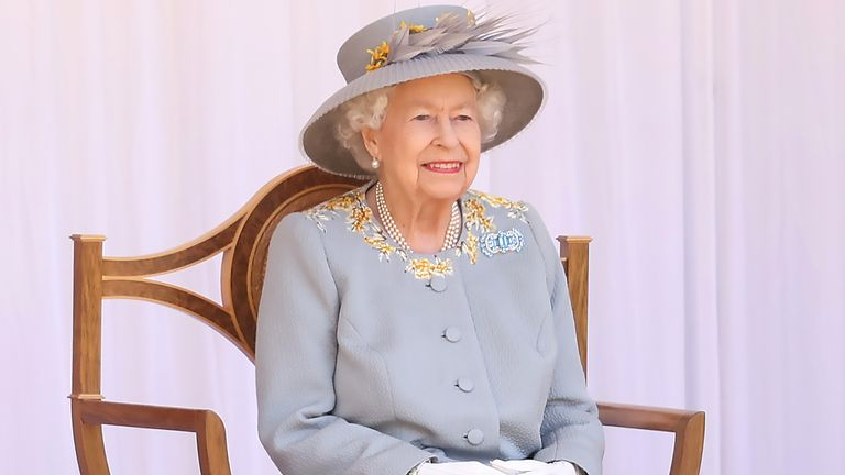 THe Queen watches the Red Arrows fly over during a ceremony at Windsor Castle to mark her official birthday