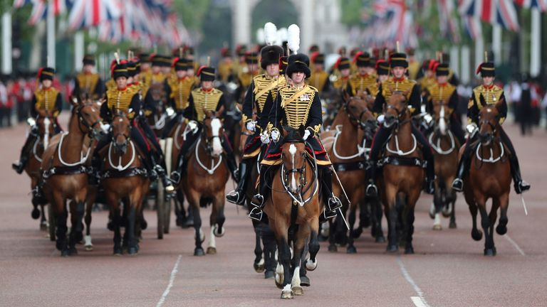 Horsemen ride down The Mall during the Trooping the Colour parade in 2019