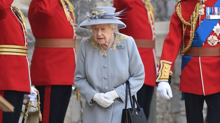 The Queen prepares to receive the salute during a ceremony at Windsor Castle to mark her official birthday