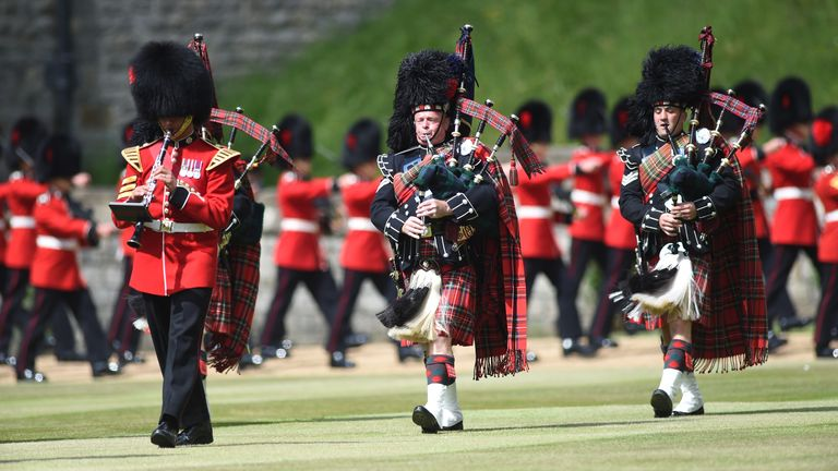 Members of the Massed Band of the Household Division perform during the ceremony at Windsor Castle