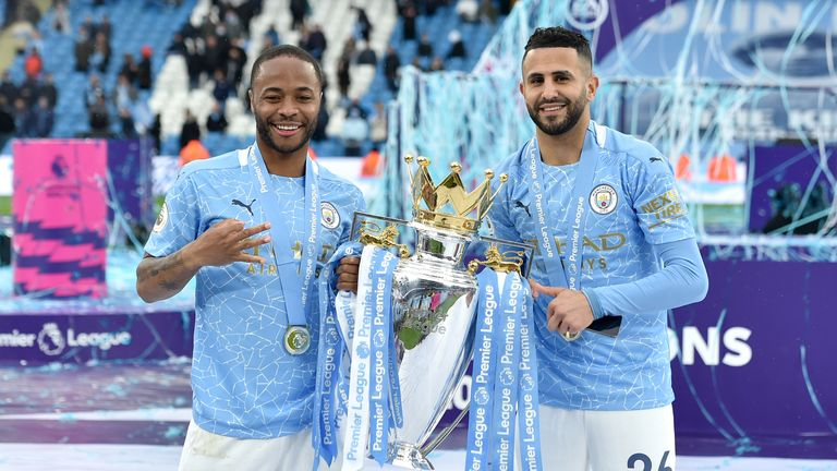Sterling (L) and Manchester City teammate Riyad Mahrez pose with the Premier League trophy