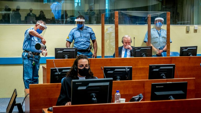 Mladic appeared inside a glass dock. Pic: AP