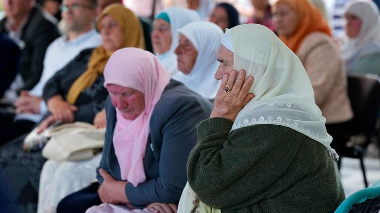 Women from Srebrenica watch a live broadcast of Mladic's hearing. Pic: AP