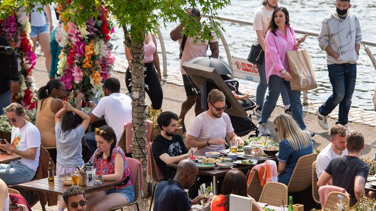 People enjoy the sun at outdoor restaurant tables in Kingston, London, as Bank Holiday Monday could be the hottest day of the year so far - with temperatures predicted to hit 25C in parts of the UK. Picture date: Monday May 31, 2021.