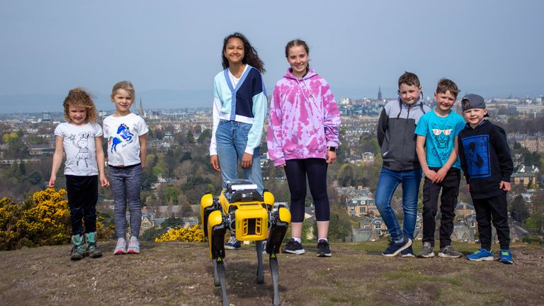 School pupils with the robot dog that is helping scientists with research in Scotland