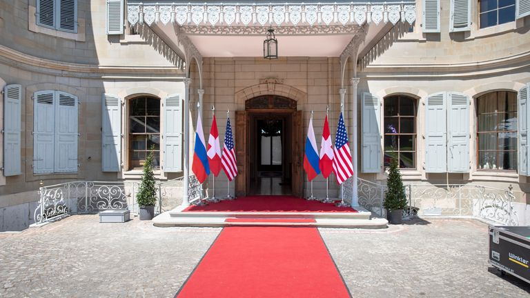 Flags of the US, Russia and Switzerland are pictured in front of the entrance of villa La Grange, one day prior to the meeting of Joe Biden and  Vladimir Putin in Geneva,3