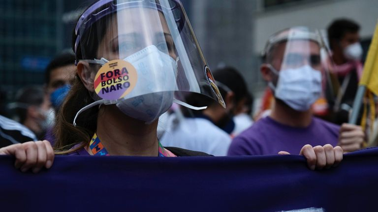 The protesters, unlike their president, believe masks can help slow the spread of the virus