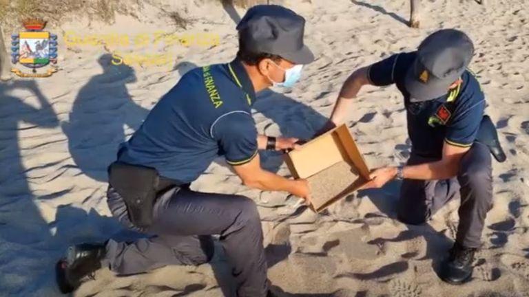 Sardinia's police return stolen sand to the beach. Pic: La Guardia di Finanza