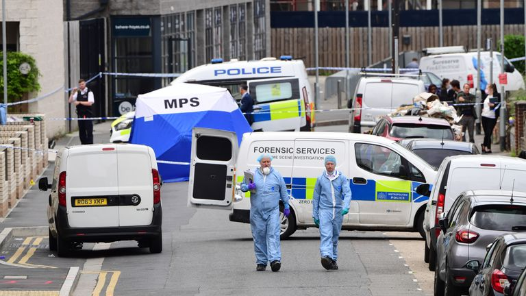 Police forensic officers on Blyth Road in Hayes, west London, where a 15-year-old boy has died after being stabbed
