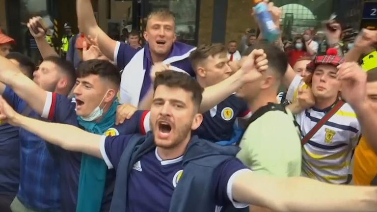 Scotland fans arrive in high spirits at King's Cross Station.
