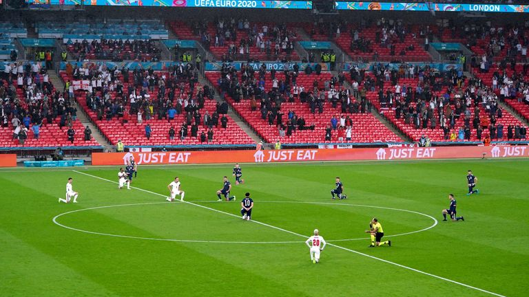 England and Scotland players take a knee ahead of the UEFA Euro 2020 Group D match at Wembley Stadium, London. Picture date: Friday June 18, 2021.