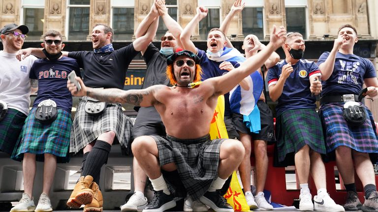 Scotland fans at Central station in Glasgow as they prepare to travel to London