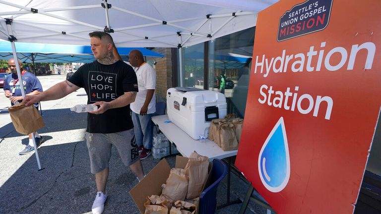 A local Christian group gives out water in Seattle on Monday. Pic: AP