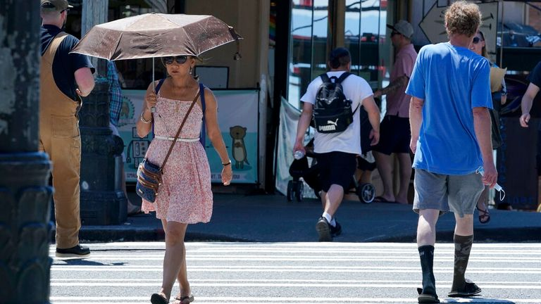 People shade from the heat in Seattle, Washington. Pic: AP