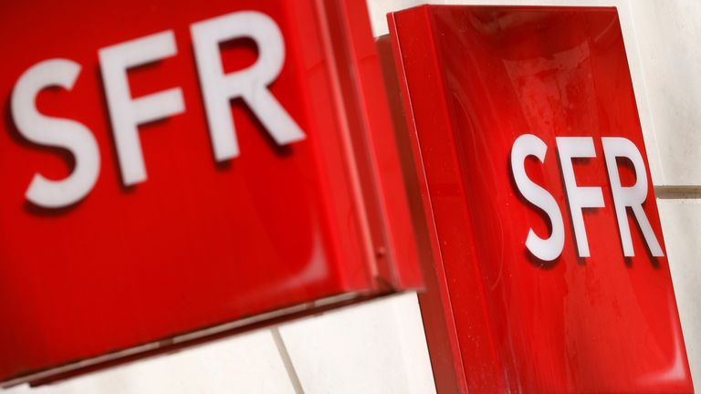 Logos of French telecoms operator SFR are pictured on a shop in Niort, France, March 4, 2021.