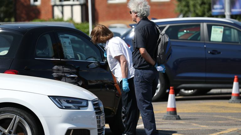Customers at Motorpoint Chingford car dealer in north London, as car showrooms reopen to the public following the introduction of measures to bring England out of lockdown. PA Photo. Picture date: Monday June 1, 2020. See PA story HEALTH Coronavirus. Photo credit should read: Yui Mok/PA Wire..