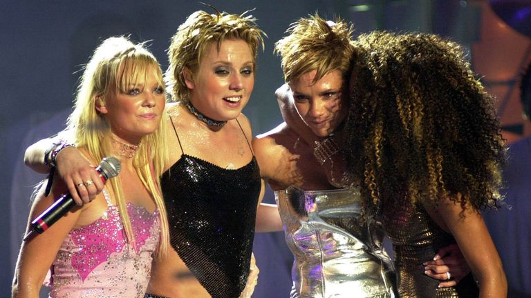 Victoria Beckham (second right) is comforted by Emma Bunton, Mel C and Mel B as she becomes overwhelmed with emotion during the Spice Girls performance at the Brit Awards, where they received the outstanding contribution to British music prize, in March 2000