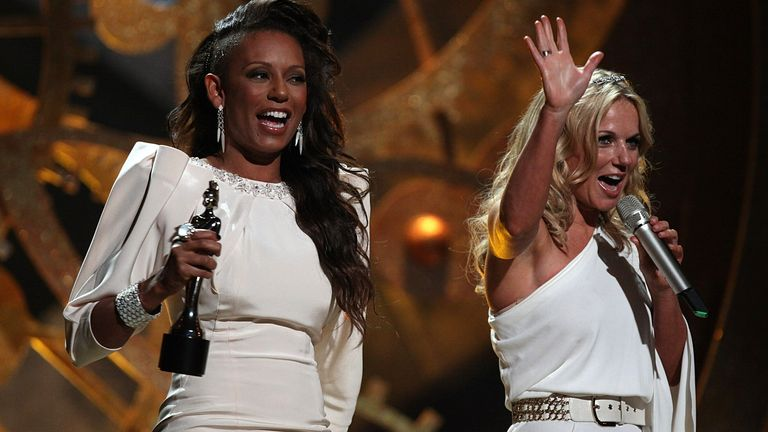Geri Halliwell (right) and Melanie Brown (left) collect the award for 'Best Brit perforance of 30 years' on behalf of the Spice Girls during the Brit Awards 2010