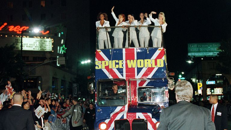 The Spice Girls wave from the top of a bus on Hollywood Boulevard for the premiere of Spice World the film in January 1998