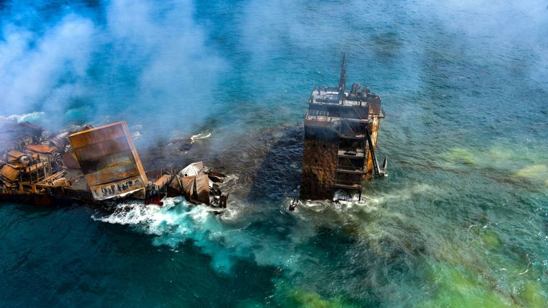 Smoke rises from a fire onboard the MV X-Press Pearl vessel as it sinks while being towed into deep sea off the Colombo Harbour, in Sri Lanka