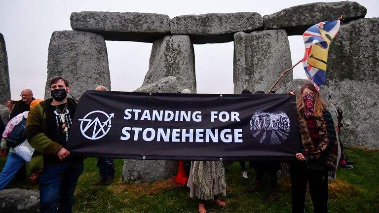 People held up a banner saying 'Stand for Stonehenge' at the monument